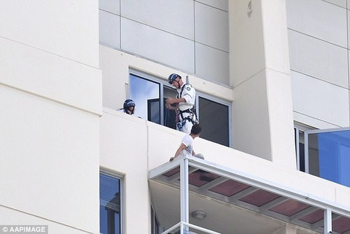 The man was on the roof of the apartment beneath him for 12 hours yesterday as he negotiated with police