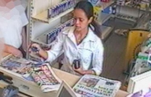 Girma buys a newspaper in a newsagents in Brighton, as she helped Osman hide from police shortly after the failed bomb plot in 2005