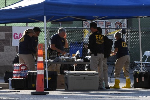 FBI investigators work outside the Route 91 music festival site beside the Mandalay Bay resort Hotel after a gunman fired and killed 58 people