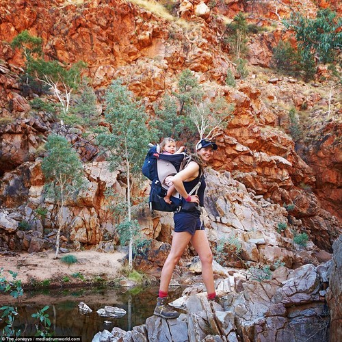 Rock on! Thirty-seven-year-old Lauren takes a stroll across rough terrain with Morgan, one, on her back