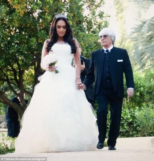 Blushing bride:Tamara Ecclestone has lashed out at cruel trolls who claimed she looked like a 'giant' on her wedding day next to her 'dwarf' father Bernie Ecclestone