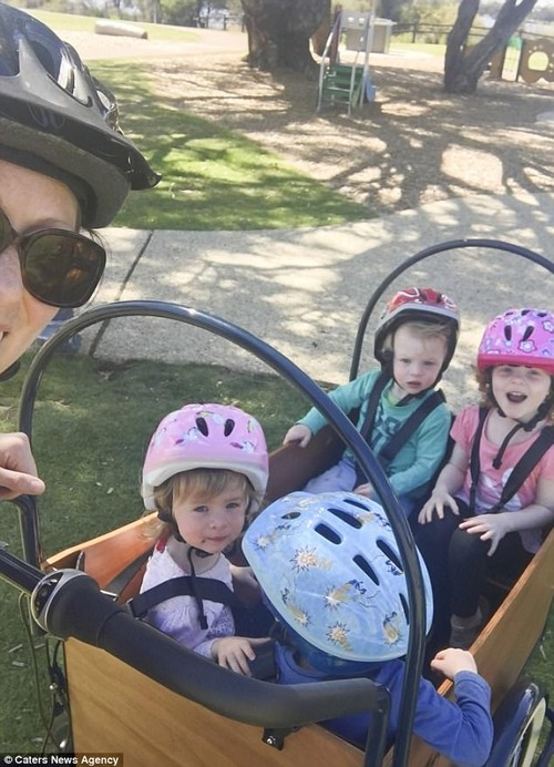 'I have a cargo bike that I strap the kids into and I use it to take them to school, to the market and to the library,' Taryn said (picturedtaking Ava, Euan, Posey and Bryn out for a bike ride)