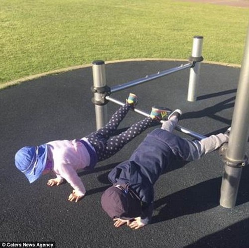 'I love involving the kids because they learn the importance of being active' (pictured two of her children taking part in their mother's workout)