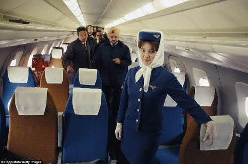 Guests inspect the interiors of the new Soviet-built aircraft at a press launch at Moscow airport on May 21, 1969