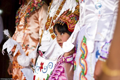 Traditional dress: Annapurna Mellor captured this candid photo while visiting the Shan State in Myanmar. A young girl is seen wearing make-up and dressed in traditional costume