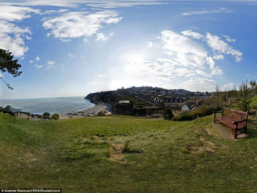 Vista: A panorama looking down on the beach an coastal town of Beer in South Devon