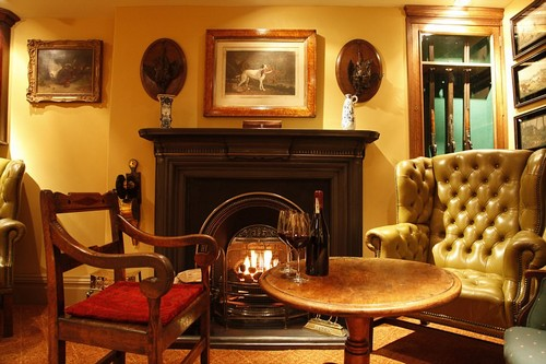 Snug: A roaring fire, a bottle of red wine and a wing-backed leather armchair invite guests to relax for the evening