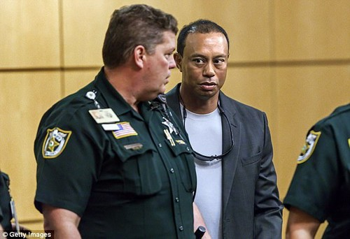 Tiger Woods (right) leaves Palm Beach County court in Palm Beach Gardens on Friday