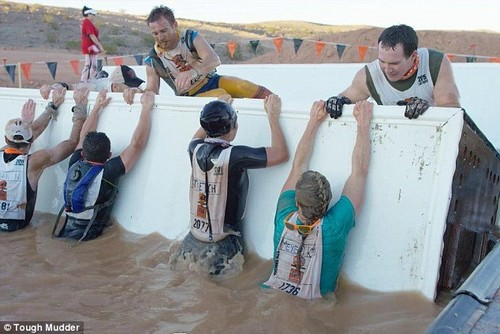 The 'Block Ness Monster' requires participants to work together and push, pull, and roll their way through slick, rotating barriers