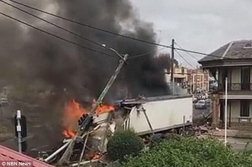 Ms Anderson said the stolen truck crashed into a car which crashed into her car, throwing her sideways and all she could see 'was smoke' (pictured)
