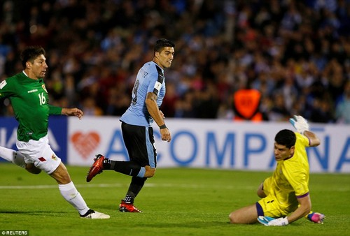 Barcelona striker Suarez beats the Bolivia goalkeeper from close range to put Uruguay 3-1 up in the second-half