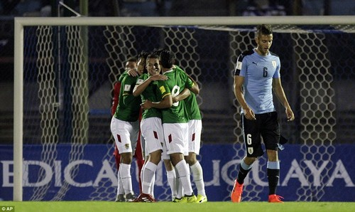 Bolivia celebrate after they took an early in Montevideo through a comedy own goal from Gaston Silva