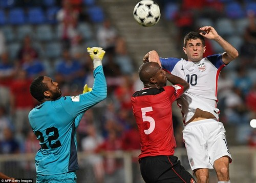 Trinidad and Tobago's Adrian Foncette (L), Trinidad and Tobago's Daneil Cyrus and USA's Christian Pulisic jump for the ball during their 2018 World Cup qualifier football match in Couva, Trinidad and Tobago, on October 10, 2017