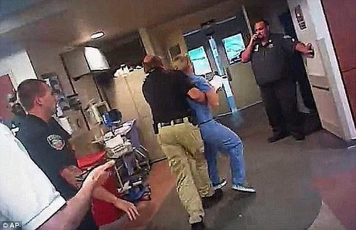 In a disciplinary letter, Salt Lake City Police Chief Mike Brown said he was 'deeply troubled' by Payne's conduct, which he described as 'inappropriate, unreasonable, unwarranted, discourteous, disrespectful' (Pictured, Payne arrests Wubbels)