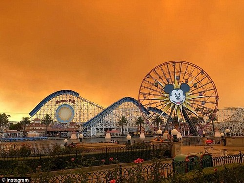 The smoke from an Anaheim Hills brush fire turned the sky into a pumpkin orange. It is seen above Disneyland's California Adventure park