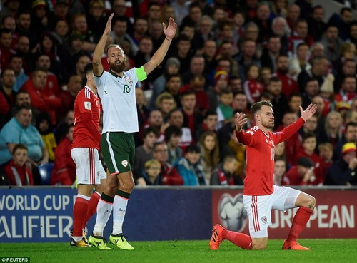 Arsenal playmaker Aaron Ramsey is brought down by Republic of Ireland captain David Meyler, who pleads his innocence