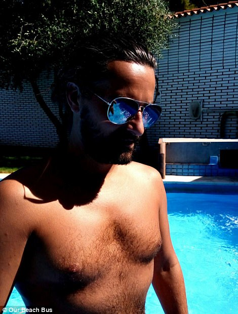 David shows off his impressive tan by a pool in the sun