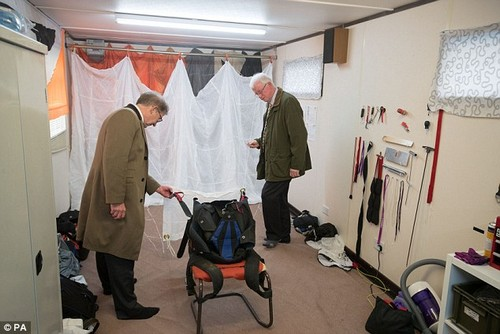 Trial judge Mr Justice Sweeney, right, and prosecution barrister Michael Bowes, QC, left, are pictured inspecting a 149 reserve parachute similar to the one used by Mrs Cilliers