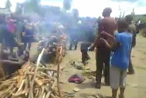 Rebel leaders force the woman to have sex with the son of her husband's second wife, and another woman is seen whipping the pair with branches