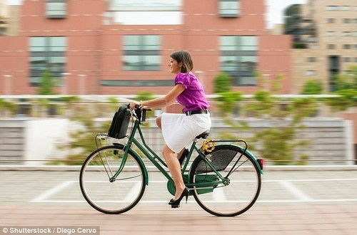 Researchers found that male and female walkers were 7lbs and 4lbs lighter respectively. Even those who took the bus or train weighed less than car-users (stock image)