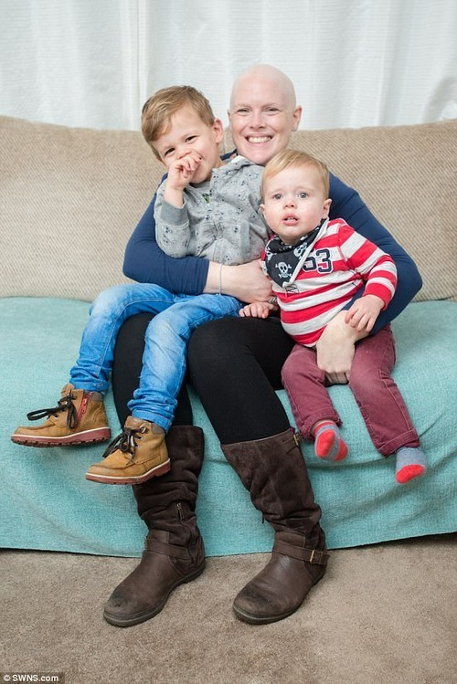 Heidi Loughlin, 35, said the world is her oyster after a revolutionary breast cancer drug helped her defy her death sentence (pictured with her sons Noah, 4, and Tait, 3)