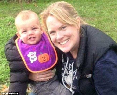 Ms Loughlin first noticed something was wrong when she was breastfeeding youngest son Tait (pictured together) in February 2015, and noticed a rash