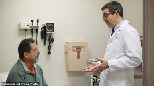 Daniel Lobello (left) speaks with his urologist, Dr Matthias Hofer (right) at Northwestern Memorial Hospital in Chicago. Lobello, 60, thinks a lot of men probably would start using cheaper generic or brand-name Viagra. 'It's great' that the prices are getting cut, said the electrical inspector, 'because it's something men need'