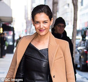 Actress Katie Holmes looked resplendent in a dress that accentuated her nipped-in waist at a recent event with her boyfriend Jamie Foxx