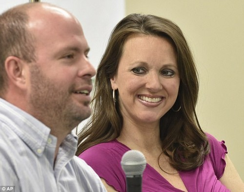 Mother Courtney Waldrop, 35, looks on at her husband Eric, 35, during a press conference at Huntsville Hospital in Alabama
