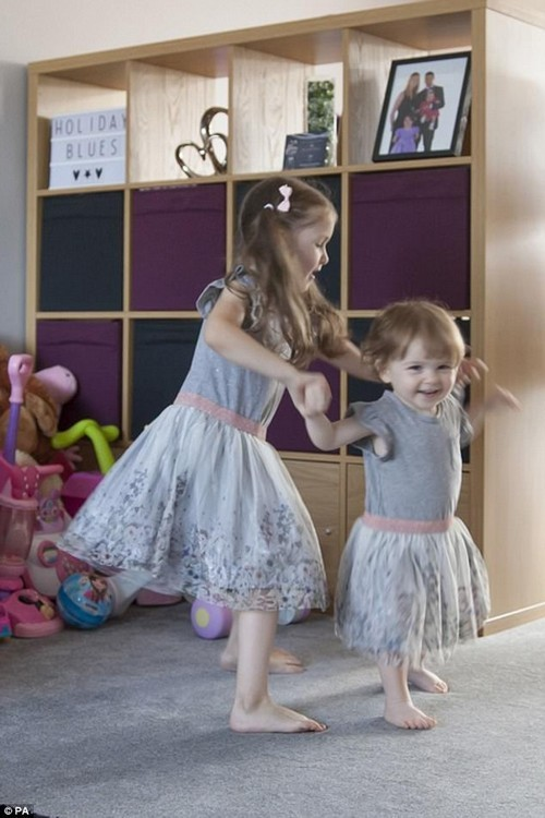 Sisters, who are the only siblings in the world to suffer from a deadly condition that leaves survivors paralysed, love dancing after the eldest (left) took her first steps on Christmas Day
