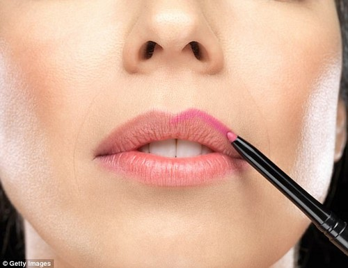 Avoid heavy coloured liner if you don't want to look older and opt for a more neutral shade that matches your skin tone instead (stock image)