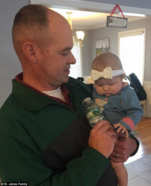 Lieutenant Steven Tenney donated part of his liver to Sloan St James (left) when she was five months old after she was in stage 4 liver failure