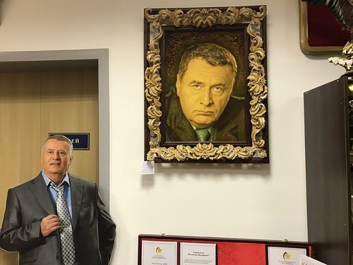 A cardboard cutout and portrait of Zhirinovsky at his campaign headquarters