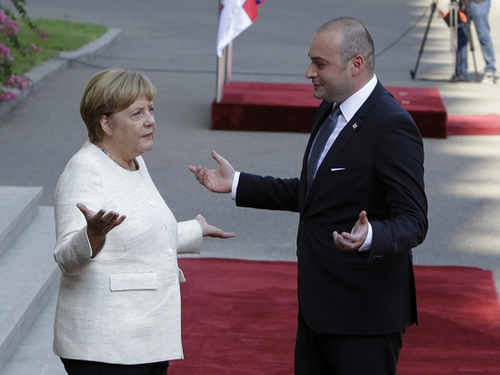Merkel in the Caucasus was looking for a gas pipe, and she found a Russian base