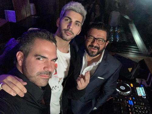 Tomas de la Hoz and Carlos Pereyra with DJ Ivann Delamo.
