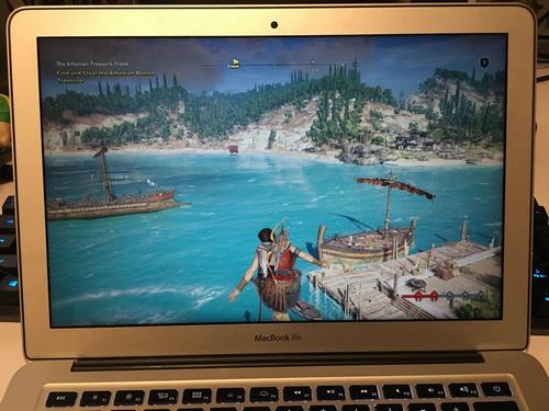Assassin's Creed Odyssey played on a MacBook Air through the Shadow application.