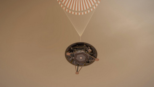 A simulated view of InSight descending with its parachute.
