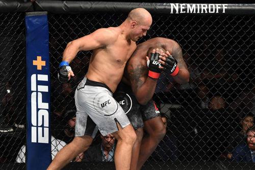 dos Santos beating Lewis down.