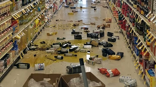 This handout picture obtained courtesy of Rex Emerson taken on July 4, 2019 shows broken bottles and other goods in a store in Lake Isabella, California after a 6.4 magnitude quake hit Southern Califo
