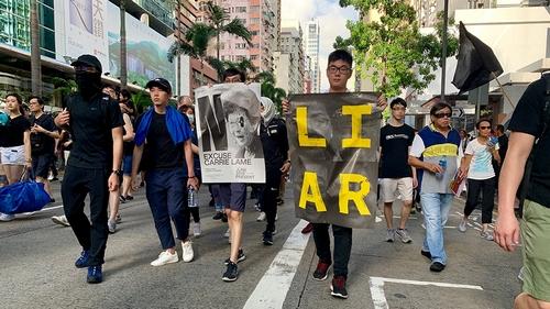 Hong Kong mayhem as police fire tear gas at protesters