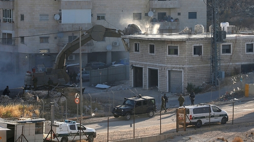 An Israeli machinery demolishes a Palestinian building in the village of Sur Baher which sits on either side of the Israeli barrier in East Jerusalem and the Israeli-occupied West Bank July 22, 2019.