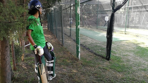 Julieta Marquina waiting to bat at a training session. Courtesy of Lauren Cocking.