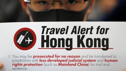 Hong Kong leader warns of economic 'tsunami' if protests continue