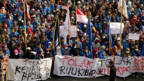 University students march to local parliament building during a protest in Makassar