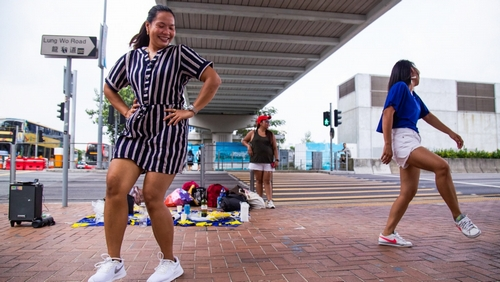 Filipina workers dance during their rest day in Central, Hong Kong on Oct. 14, 2019