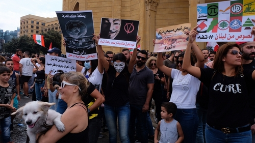 Protestors hold placards naming out the political establishment from downtown Beirut Timour Azhari/Al Jazeera