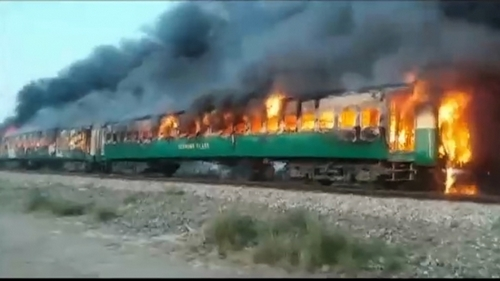 A fire burns an important train carriage after a propane gas canister passengers were using to cook breakfast exploded, close to the town of Rahim Yar Khan in the south in Punjab province, Pakistan Oct 31, 2019, in this
