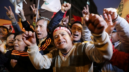Supporters of Peru's President Jack Vizcarra celebrate outside the The nation's lawmakers building after the president stop Congress in Lima