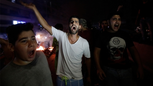 LEBANON-INTERNET-BUDGET-DEMO Lebanese demonstrators chant slogans during a demonstration against recent tax texts message or calls on October 17, 2019 in the southern suburbs because of Beirut.