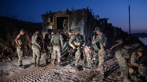First group of Turkish infantry prepare to enter Syria on the border between Turkey and Syria on October 09, 2019 in Akcakale, Turkey. The military action is part of a campaign to extend Turkish contr